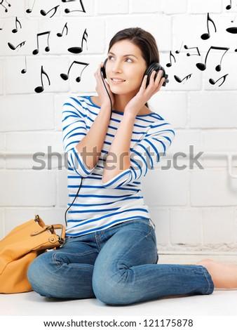 picture of happy teenage girl in big headphones - stock photo