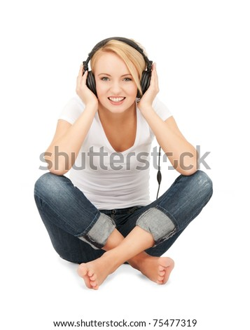 picture of happy teenage girl in big headphones