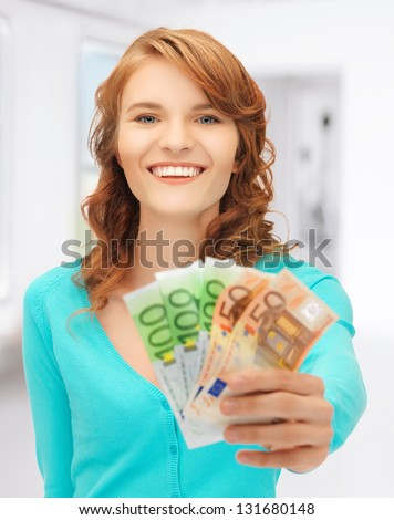 picture of happy teenage girl with euro cash money - stock photo