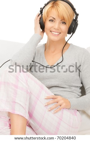 picture of happy woman in headphones over white - stock photo