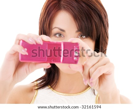 picture of happy woman using phone camera - stock photo
