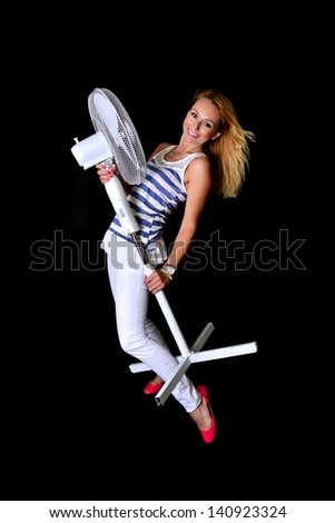 picture of happy woman with big fan - stock photo