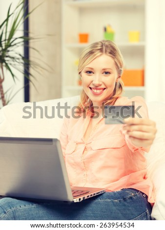 picture of happy woman with laptop computer and credit card.. - stock photo