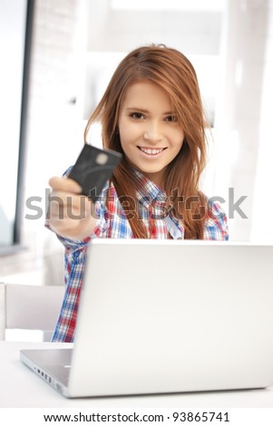 picture of happy woman with laptop computer and credit card - stock photo