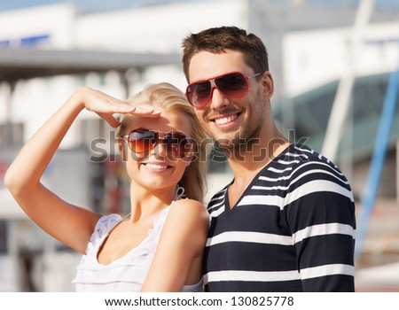picture of happy young couple in port - stock photo