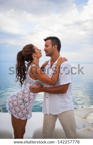 picture of happy young couple on their yacht