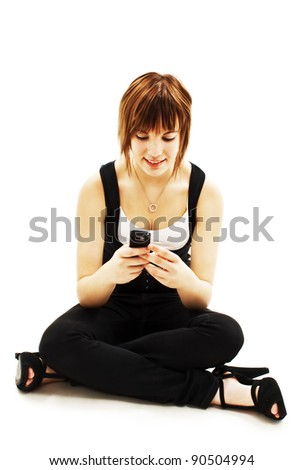 Picture of happy young woman with cell phone. Isolated on white background - stock photo