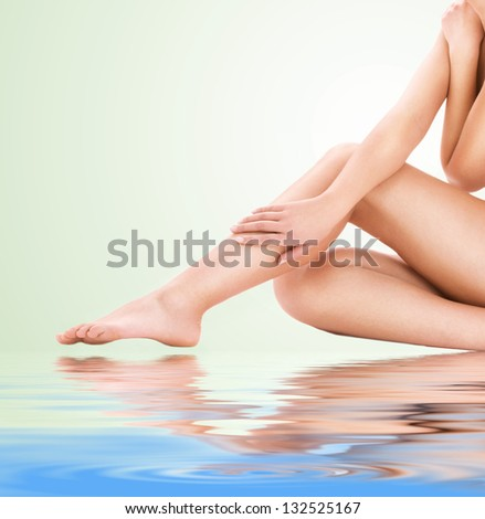 picture of healthy naked woman legs over green background