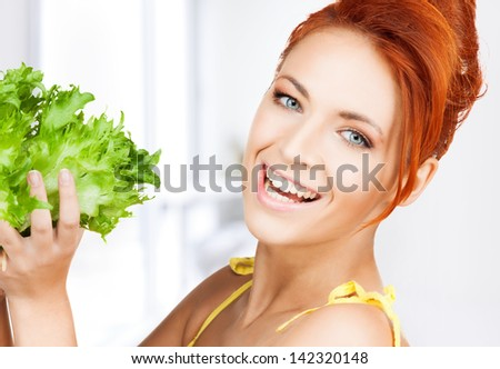 picture of healthy woman holding bunch of lettuce - stock photo