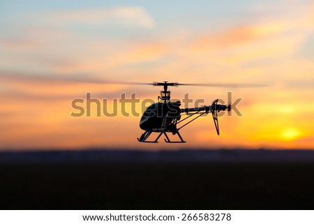 Picture of helicopter at sunset - stock photo