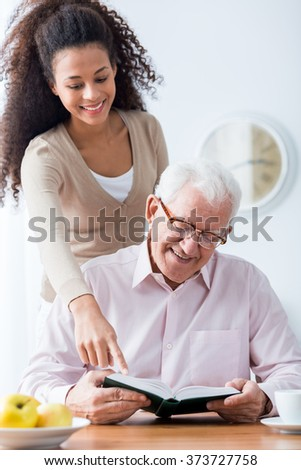 Picture of helpful woman and old ill man - stock photo
