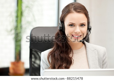 picture of helpline operator with laptop computer - stock photo