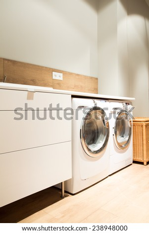 Picture of home laundry with two washing machines - stock photo