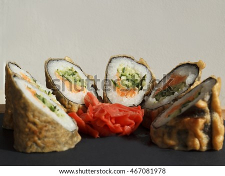Picture of hot sushi over black background