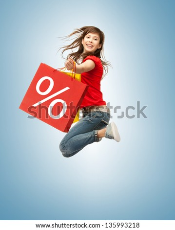 picture of jumping teenage girl with shopping bags