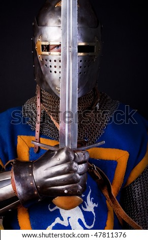 Picture of knight holding his sword - stock photo
