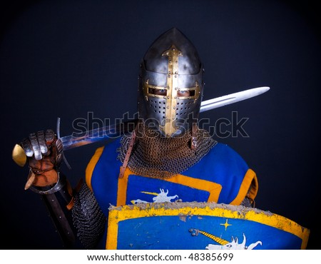 picture of knight holding his weapons - stock photo