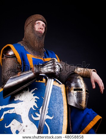 picture of knight with his sword, shield and helmet - stock photo