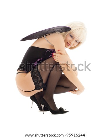 picture of lingerie angel girl in stockings on high heels - stock photo