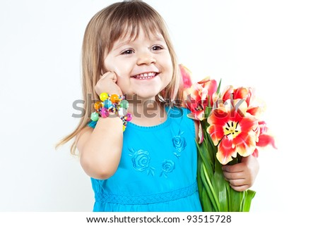 Picture of litlle girl with tulips in hands over white