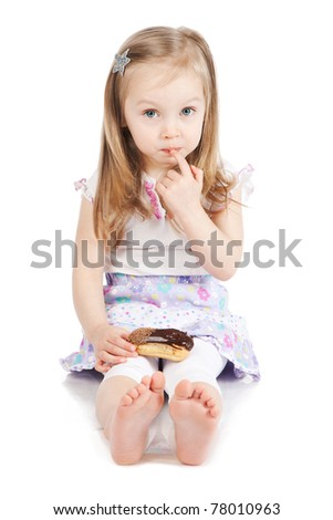 Picture of little cute girl eating chocolate cake isolated on white background