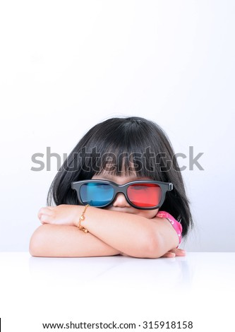 Picture of little girl wearing 3D glass - stock photo