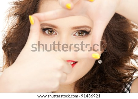 picture of lovely woman creating a frame with fingers. - stock photo