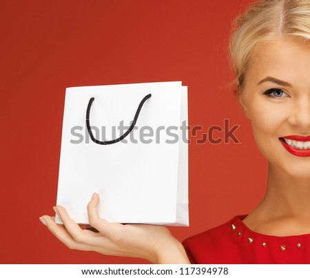 picture of lovely woman in red dress with shopping bag - stock photo