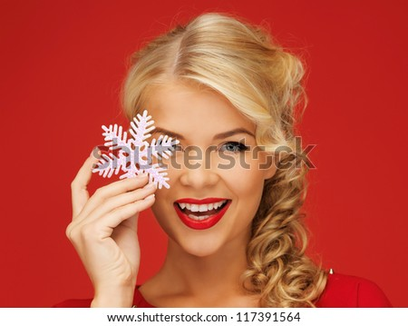 picture of lovely woman in red dress with snowflake - stock photo
