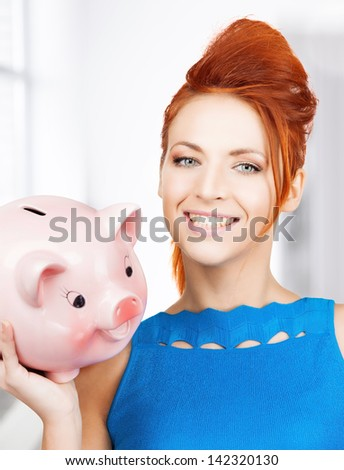 picture of lovely woman with big piggy bank - stock photo