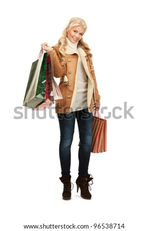 picture of lovely woman with shopping bags. - stock photo