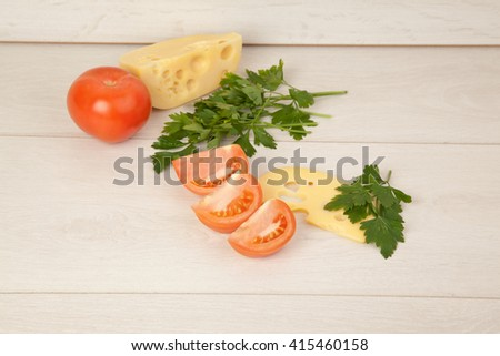 Picture of maasdam, chopped tomatoes and parsley - stock photo