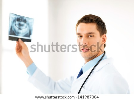 picture of male doctor or dentist with x-ray