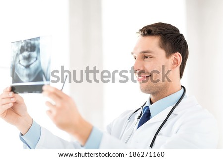 picture of male doctor or dentist with x-ray - stock photo