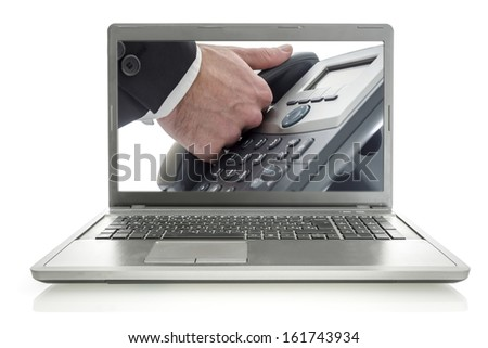 Picture of male hand holding telephone receiver on a laptop monitor. Online support phone concept.