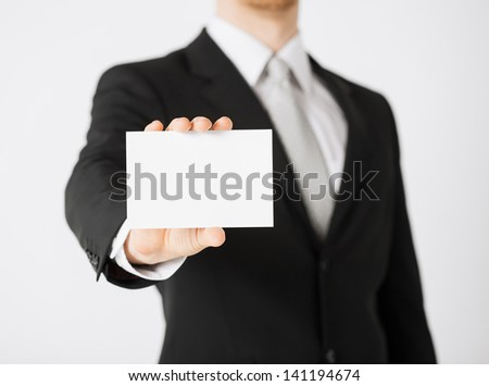 picture of man hand with blank paper - stock photo