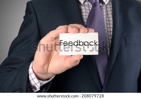 picture of man hand with card with feedback text - stock photo