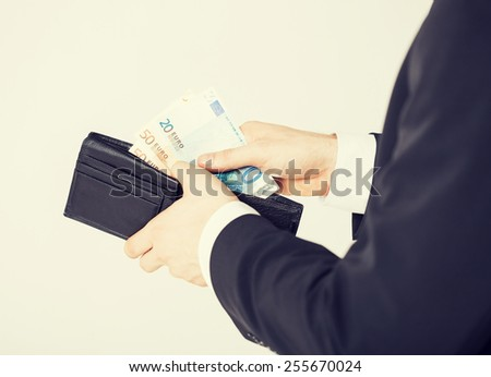 picture of man hands with purse counting euro cash money - stock photo
