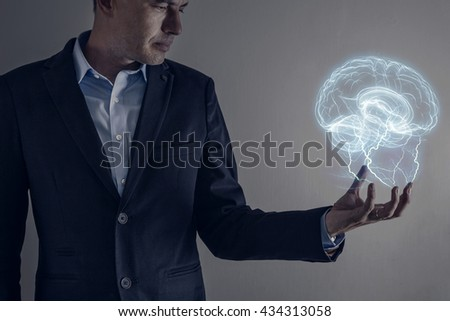 Picture of man holding a lightning strike and brain - stock photo