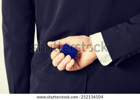 picture of man with gift box in suit - stock photo