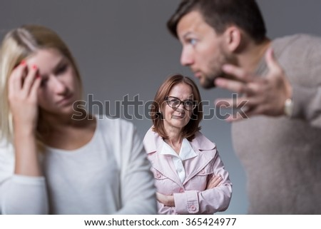 Picture of marital dispute and mean envy mother