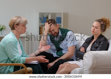 Picture of married couple in separation during therapy - stock photo