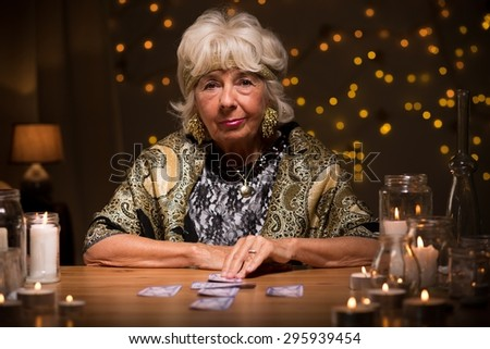Picture of mature fortune teller with tarot cards - stock photo