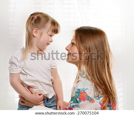 picture of mother and daughter talking with each other - stock photo