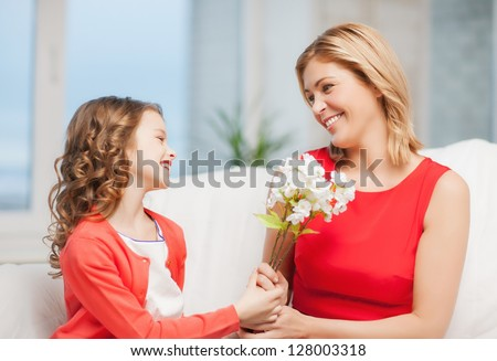 picture of mother and daughter with flowers - stock photo