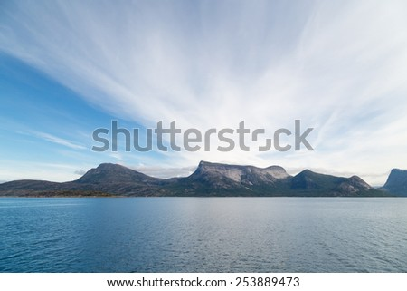 Picture of mountains with blue sea and sky