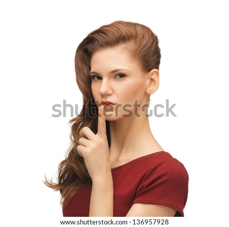picture of mysterious woman with finger on her lips - stock photo