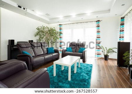 Picture of new luxury family room with brown leather couch