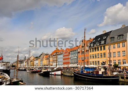 Picture of Nyhavn (New Harbour) in Copenhagen, Denmark. This historic old street borders a canal and features numerous restaurants.