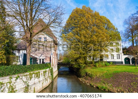 picture of old buildings along a brook in Maastricht, The Netherlands - stock photo